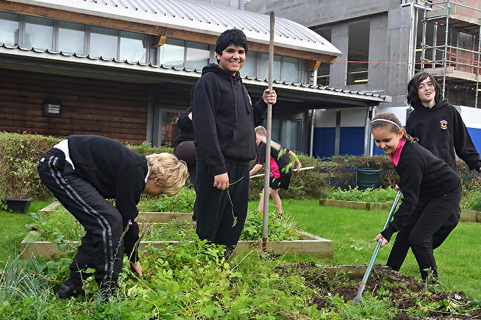 school pupils tend their allotment funded by Dorset Community Foundation